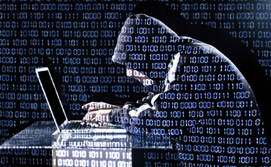 Cybercrime hacker typing on a laptop